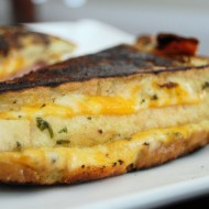 Basil Coated Grill Cheese with Prosciutto and 3 Cheeses